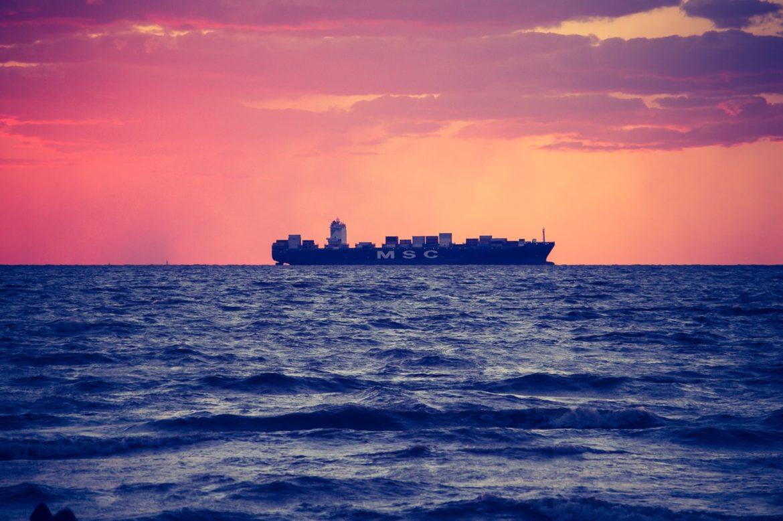 a cargo ship on the horizon